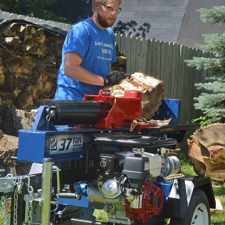 Man Using A Wooden Log Splitter