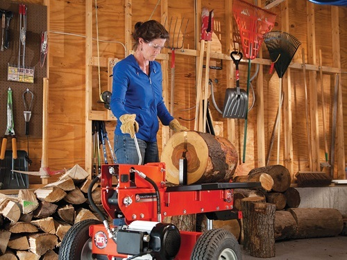 Woman Using Hidraulic Log Splitter