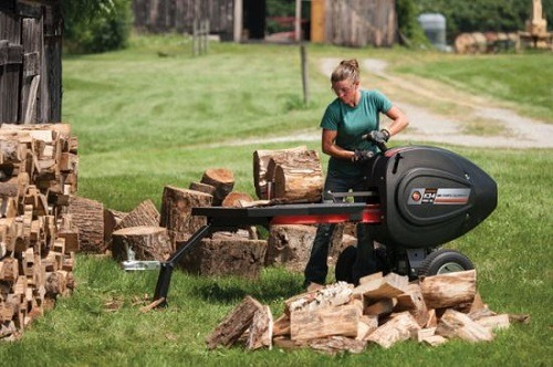Woman Using Kinetic Log Splitter